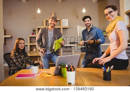 Portrait of team of graphic designers having a meeting in office