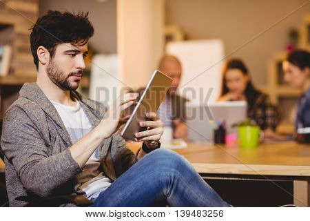 Male graphic designer using digital tablet in the office