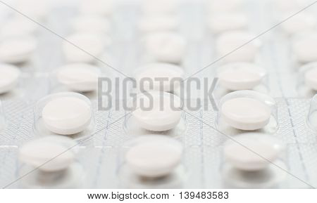 Tablets in packing by close-up. Medical background