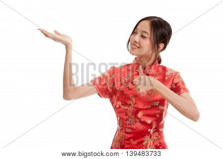Asian Girl In Chinese Cheongsam Dress  Thumbs Up With  Blank Space On Her Hand