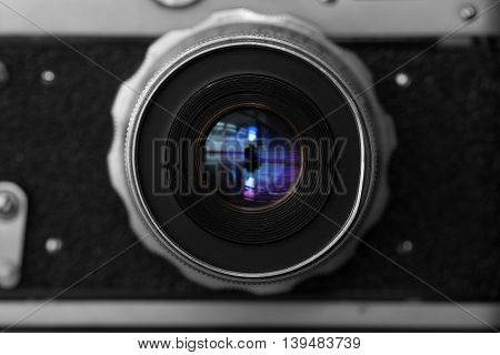 Closeup view of retro camera isolated on black