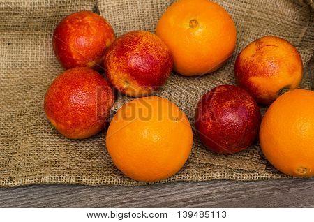 Sicilian blood ripe oranges on canvas background
