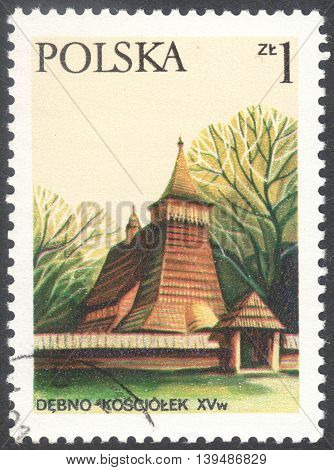 MOSCOW RUSSIA - CIRCA FEBRUARY 2016: a post stamp printed in POLAND shows a wooden church in Debno the series