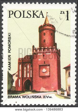 MOSCOW RUSSIA - CIRCA FEBRUARY 2016: a post stamp printed in POLAND shows Wolin Gate and Piastowska Tower in Kamien Pomorski the series