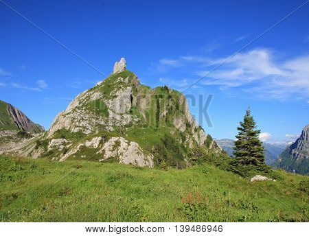 Mountain in Glarus Canton. Mt Dejenstogg in summer. Scene on a hiking route towards lake Klontalersee.