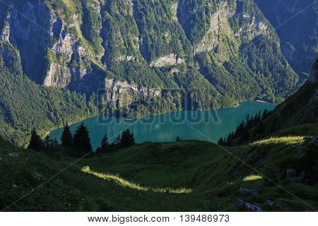 Lake Klontalersee seen from Obere Scheiterboden. Summer scene in the Swiss Alps.