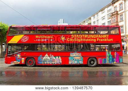 Frankfurt, Germany - June 15, 2016: A double-decker tourist sightseeing bus at Paulsplatz square in the Old Town.