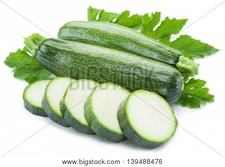 Zucchini with slices on a white background.