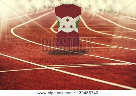 Red Running Track With Lines And Burundi Flag On Shirt