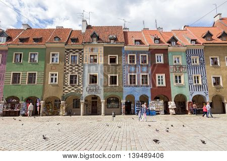 POZNAN POLAND - AUG 20 2014: Colorfull houses on the central square in Poznan. The city is the 4th largest and the 3rd most visited city in Poland.