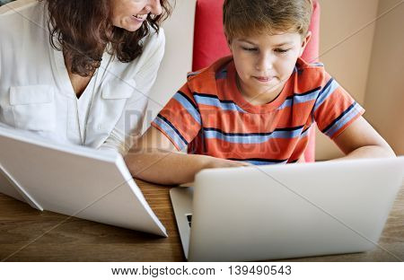Family Mother Son Using Digital Laptop Concept