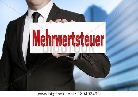 Mehrwertsteuer (in German Vat) Sign Is Held By Businessman