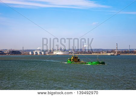 In a photo the barge floating on sea.