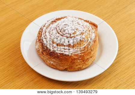 Powdered Sugar Sweet Roll Bun On Table