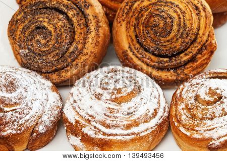 Sweet Roll Buns With Shugar Powder And Poppy On Table