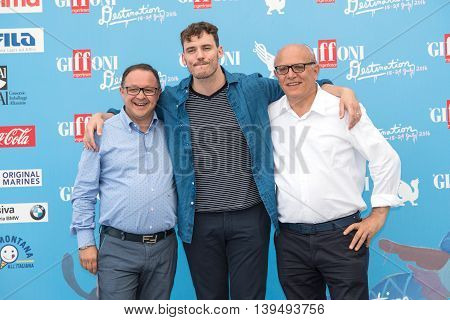 Giffoni Valle Piana SA ITALY - July 21 2016: Actor Sam Claflin Claudio Gubitosi and Pietro Rinaldi on photocall at Giffoni Film Festival 2016 - on July 21 2016 in Giffoni Valle Piana Italy.