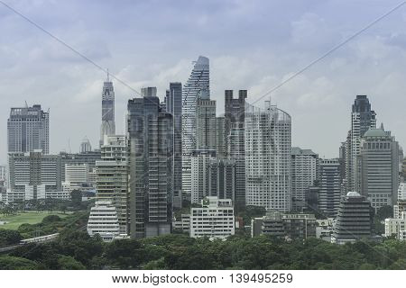 urban cityscape and park of view contain buildings and tree and sky and clouds - can use to display or montage on product