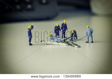 accident in mini worker scence and rescue team to help him and free space for fill text - can use to display or montage on product