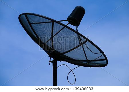 Antenna communication satellite dish with blue sky.