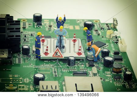 group of mini workers are try to repair a chip on mainboard with vintage filter - can use to display or montage on product or concept of on process to fix