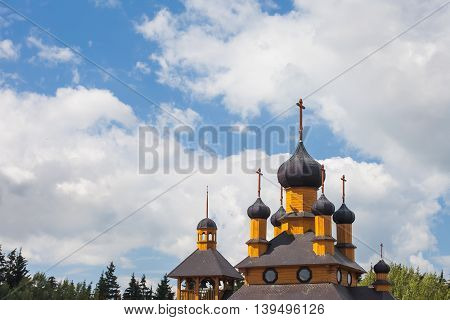 domes of the wooden Orthodox Church against the sky