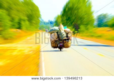 Overload motorcycle speeds on the road .