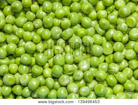pile of green peas on the background