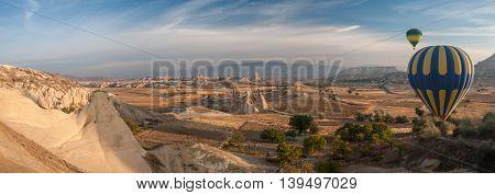 The balloon flies over a mountain valley Cappadocia panorama.