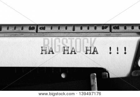 Typewriting on an old typewriter. Typing text: ha ha ha !!!