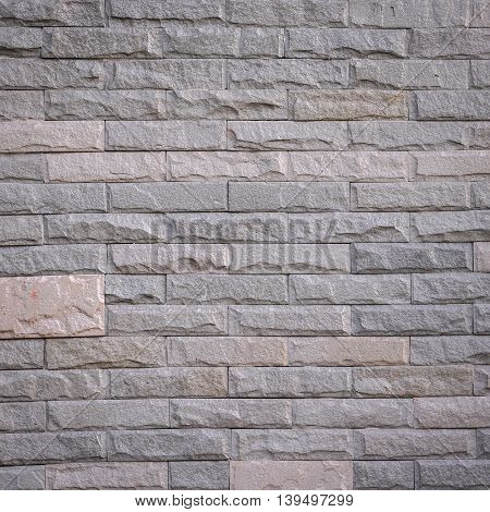 gray rock brick wall texture and background