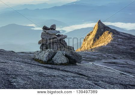 Stacked mountain stones at the summit of mountain Kinabalu.Harmony concept