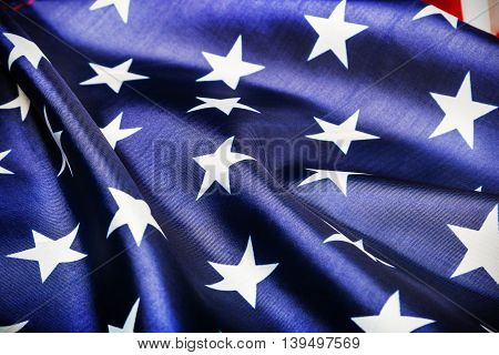 stars on the American flag Close-up background. vignetting for artistic effect