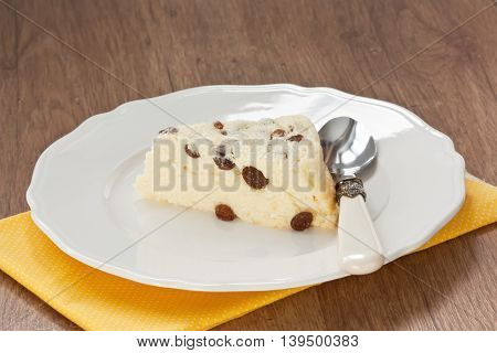 Delicious cottage cheese souffle with raisins on white plate