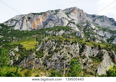 mountains in the Pyrenees of Spain on the road to Andorra with the most prominent entrance to the cave