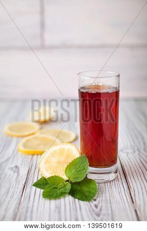 black tea lemon glass mint wooden green