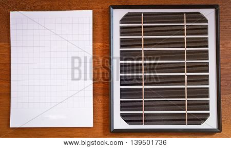 small solar panel and a notebook to record