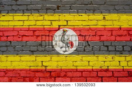 Flag of Uganda painted on brick wall background texture