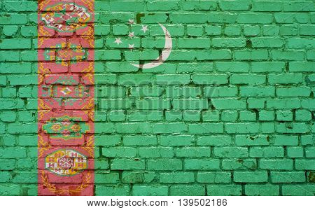 Flag of Turkmenistan painted on brick wall background texture
