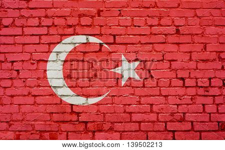 Flag of Turkey painted on brick wall background texture
