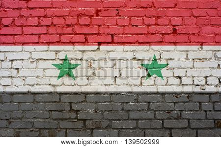 Flag of Syria painted on brick wall background texture