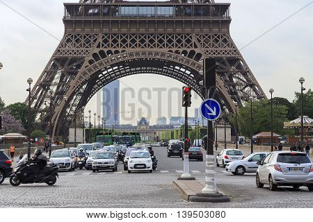 PARIS, FRANCE - MAY 12, 2015: This is a view of the Champ de Mars across the bridge of Jena and the base of the Eiffel Tower.