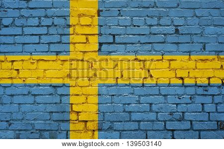 Flag of Sweden painted on brick wall background texture