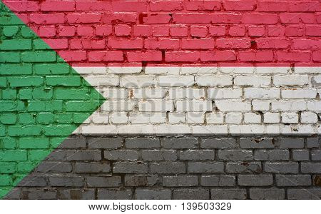 Flag of Sudan painted on brick wall background texture
