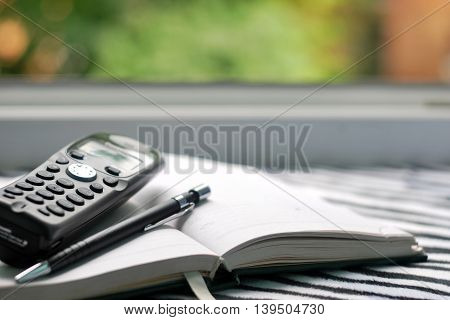 Contact us. Phone pen and note book