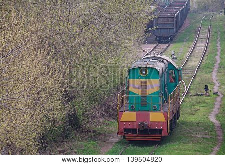 Shunting diesel locomotive standing on the siding. Transport