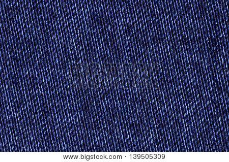 Blue cotton denim jeans fabric texture background, close up