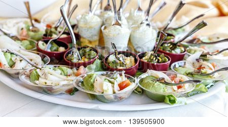 banqueting catering finger food buffet. Serving plate