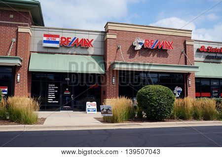 SHOREWOOD, ILLINOIS / UNITED STATES - AUGUST 30, 2015: One may buy or sell real estate with the assistance of Remax realtors, in a Shorewood strip mall.