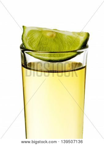 Tequila shot with lemon isolated in white background