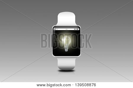 modern technology, idea, object and media concept - illustration of black smart watch with light bulb icon on screen over gray background